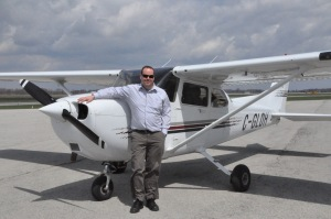 Chief Flight Instructor John Maxwell with the Cessna 172.
